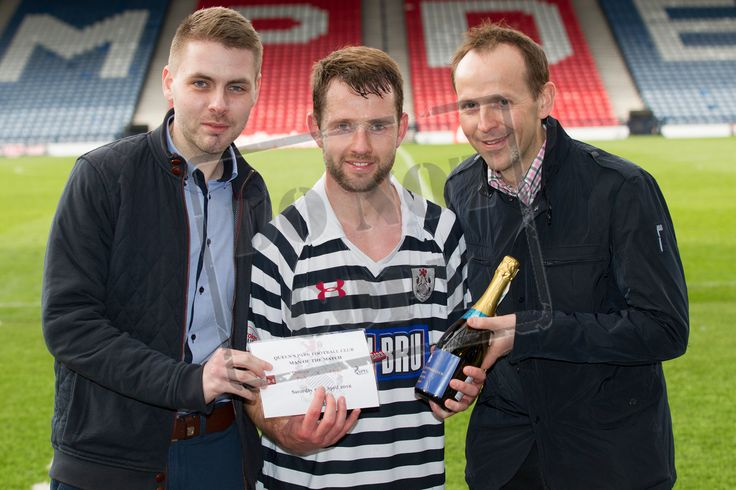 Queen's Park's Vinnie Berry receives his MOTM award from Ronald Inglis and Mark McGorm of Mitchells Roberton Solicitors and Estate Agents after the SPFL League Two game between Queen's Park and Clyde.