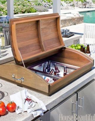 A Beverage Cooler Built Into Counter Top With Wooden Cover