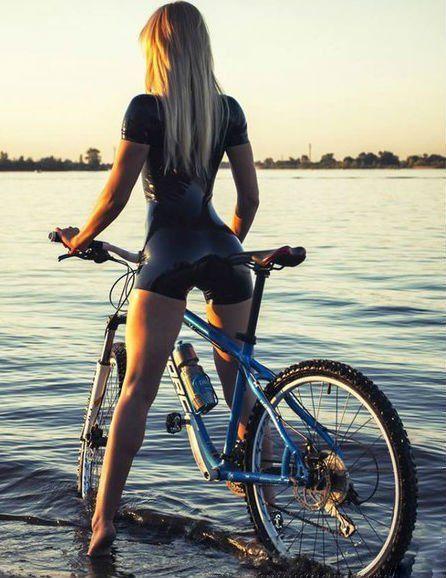 Latex Fetish sporty girl biking in latex