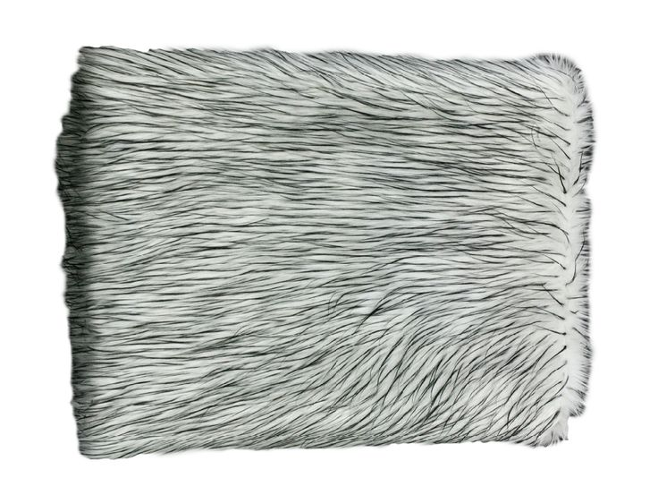 A beautiful soft white faux fur throw with black spikes, backed with a thick suede like backing perfect for those cosy nights in.