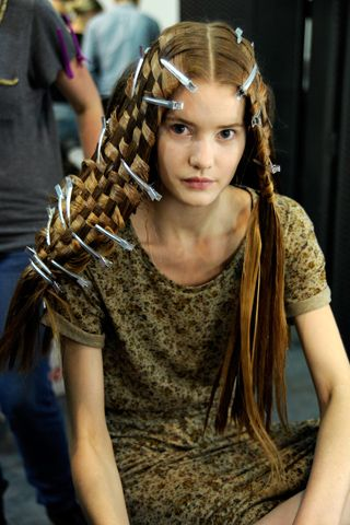 Sure, you can weave out of just about any flexible material, and many traditional hair braiding techniques actually share a lot in common with the craft of weaving in general, but this is the first time I've seen a basket weaving pattern so literally translated to hair.