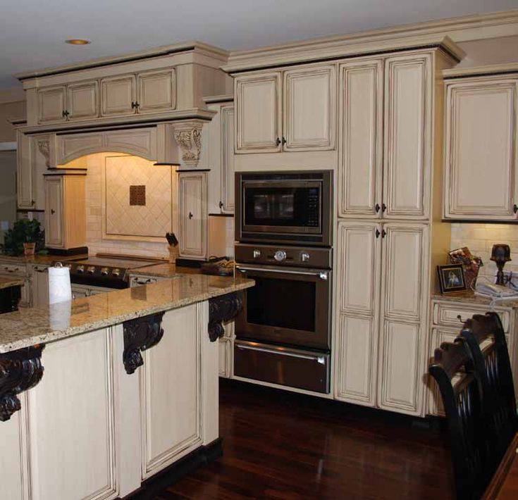 Maple wood - Painted vanilla cream and is lightly distressed with an off-white finish cabinets