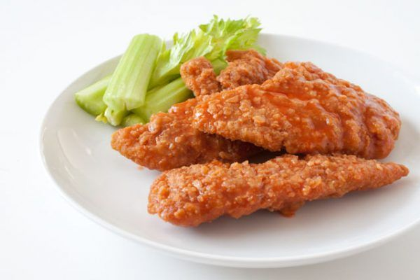 Crispy Buffalo Chicken Tenders Recipe! Everyone's favorite! Here's the secret to making super crispy buffalo chicken fingers that taste like your favorite restaurant - for half the calories! 288 calories per serving