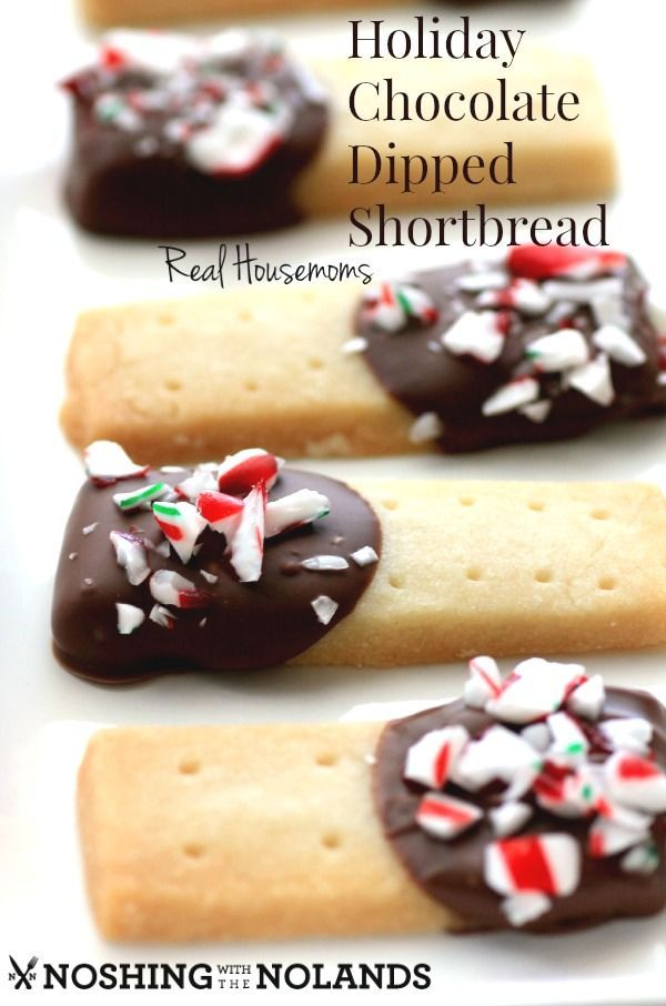 Holiday Chocolate Dipped Shortbread | Take our favorite butter cookie of all time, and dip the ends in sweet chocolate and then minty candy cane bits. That makes for one adorable, and delicious treat!  @realhousemoms