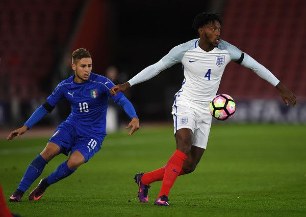Nathaniel Chalobah of England is challenged by Federico Ricci of Italy during the U21 International Friendly between England and Italy at St Mary's Stadium on November 10, 2016 in Southampton, England.