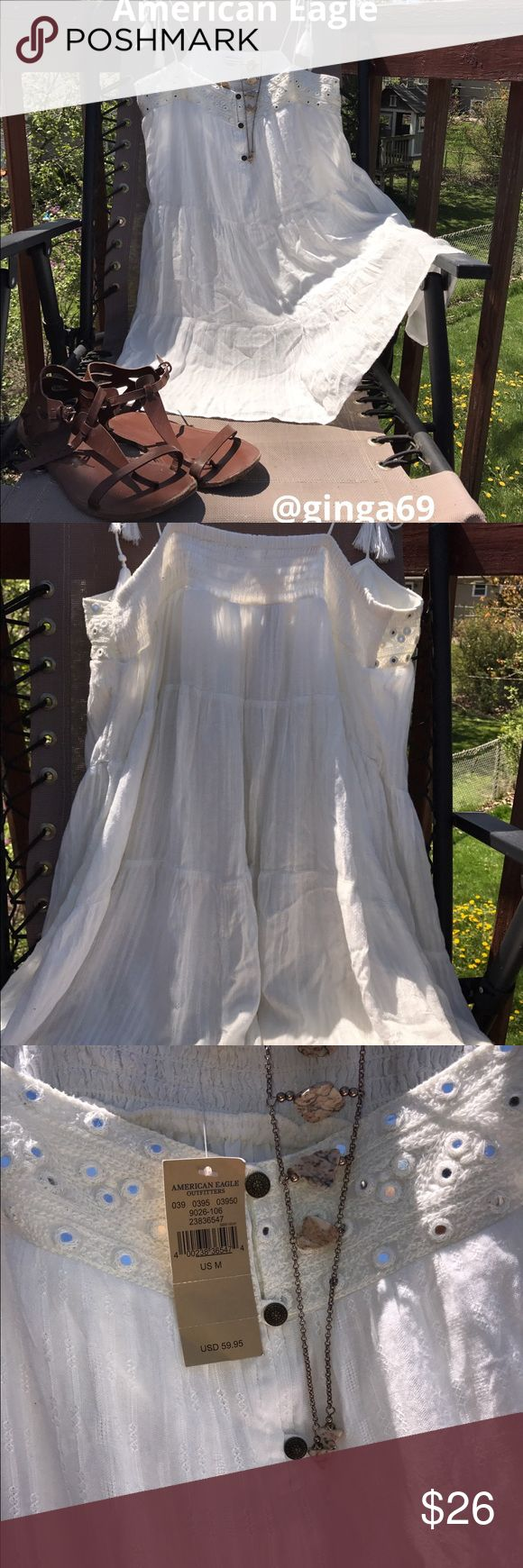 American Eagle sun dress 👗 (M) American Eagle ADORABLE white sundress ☀️. Size (M) with adjustable straps . NWT. American Eagle Outfitters Dresses Mini