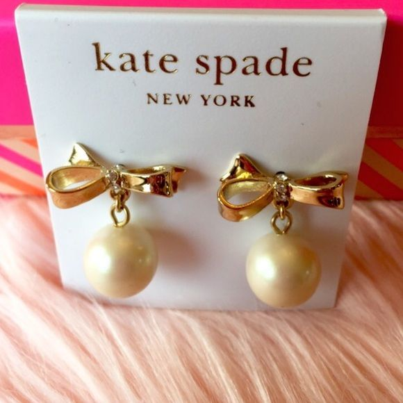 Kate spade bow with pearl drop earrings  SALE! Sophisticated and feminine- large faux pearls are suspended from gold bows decorated with crystal centers. 14k gold filled posts. Brand new! kate spade Jewelry Earrings