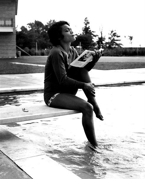 Eartha Kitt photographed at the pool by Isaac Sutton, c. 1959