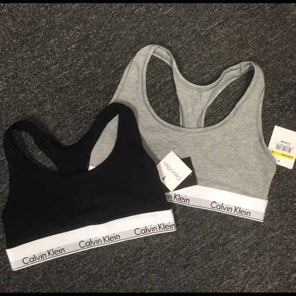 Brand new Calvin Klein sports bras (blk & grey) Light grey sports bra is size M, black sports bra is Small. Buy both for 35$ total Calvin Klein Tops