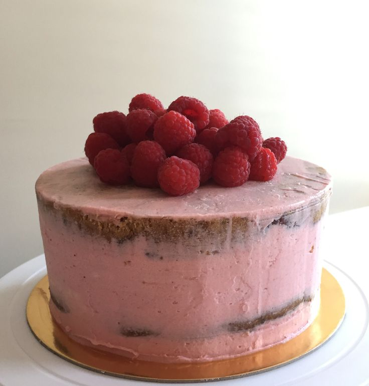 Raspberry & Hazelnut semi naked, triple layer cake with raspberry buttercream and fresh raspberries