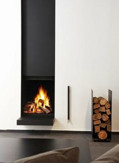 Image result for modern vertical scandinavian fireplaces