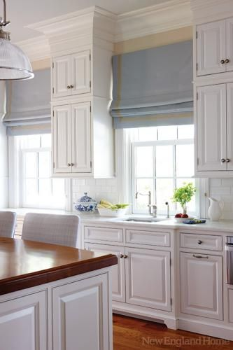 Simply lovely - traditional white kitchen, roman shades, crown moulding