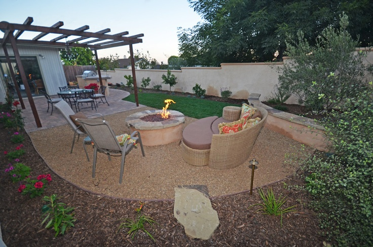 Beautiful Ventura, California backyard with BBQ area, firepit, and outdoor dining. By Scarlett's Landscape, Inc. http://scarlettslandscaping.com/