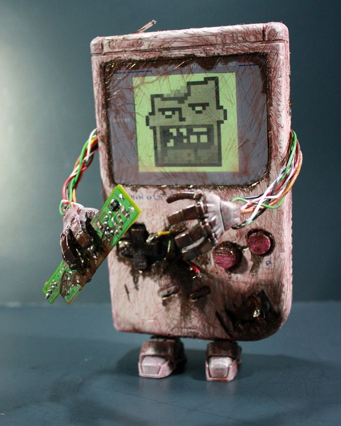 justinrampage: If you miss your old school original Game Boy, have no fear. Donald Kennedy has the power to bring it back from the dead! See more shots of his custom battery hungry Zombie Game Boy within his Flickr set. Related Rampages: Zombie Princess Peach | Yoshi (More) Custom Zombie Game Boy by Donald Kennedy (Flickr) (Twitter)