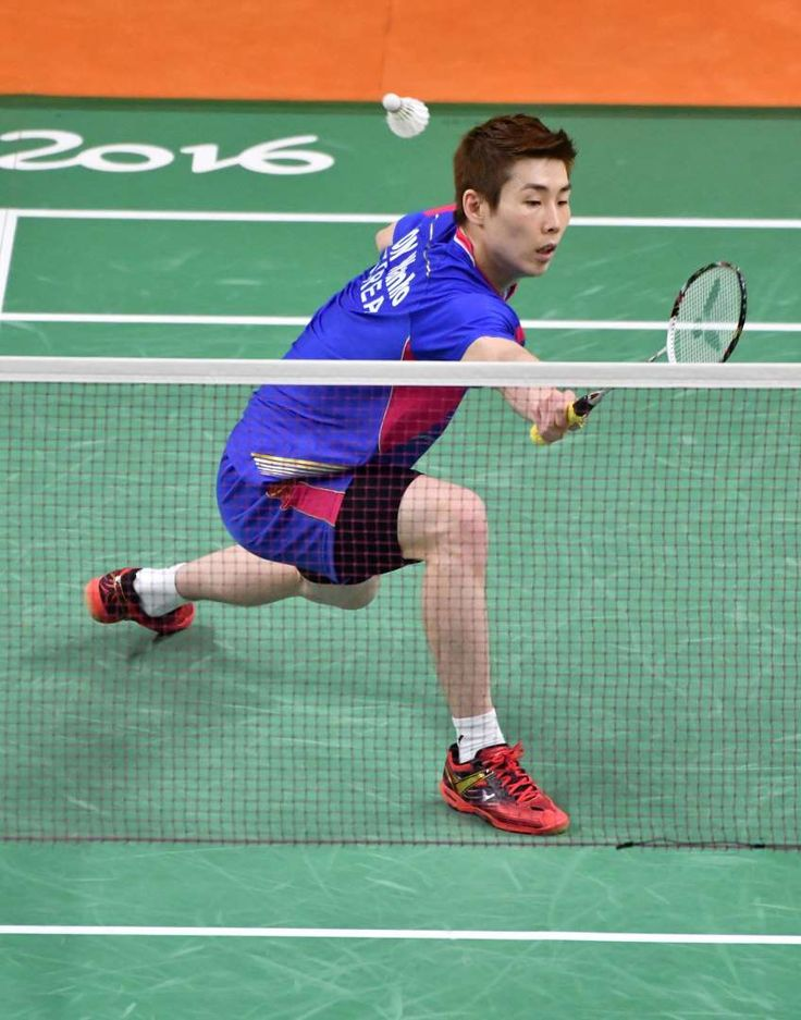 Best images from Aug. 14 at the Rio Olympics:      Wan Ho Son of South Korea stretches to return a shot to Artem Pochtarov of Ukraine during badminton men's singles group stage play in the Rio 2016 Summer Olympic Games at Riocentro - Pavilion 4.