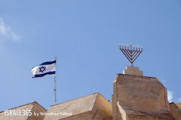 two miracles of Jewish history; the victory of the Macabees against the Greeks, symbolized by the Menorah, and the founding of the State of Israel, with an Israeli flag flying high in Jerusalem.