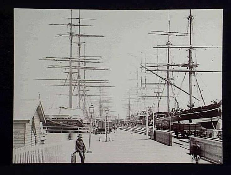 Black & white photograph of Port Melbourne Pier, Melbourne, taken by the studio of Nettleton and Arnest circa 1890. Charles Nettleton was a  photographer who worked over a period of forty years in Australia, after moving to Melbourne from the United Kingdom in 1854. In 1867, he was appointed official Royal photographer in Australia s. His photographs were exhibited at international exhibitions in Dublin in 1865, Paris in 1867 and Sydney in 1879.