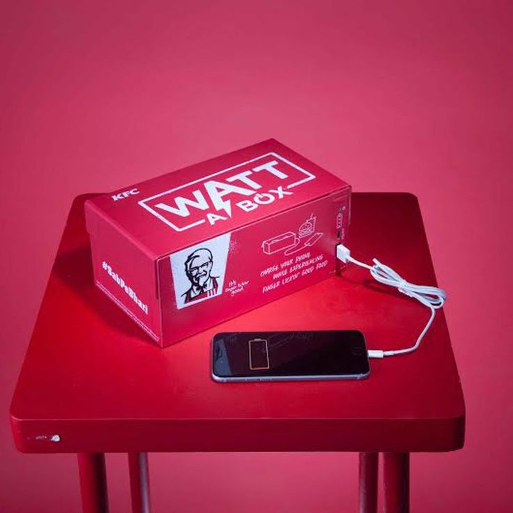 """KFC have launched a meal box in India that comes with built in outlets and cables for charging your smartphone. The meal box is called """"Watt a Box"""" and works with iPhones and Androids. People in Delhi and Mumbai can try out the limited edition box by winning a contest on KFC's Facebook page. The company launched the 5-in-1 meal box as a complete meal at an affordable price. Watt a Box has gone a step ahead to """"introduce an element of utility to the box""""."""
