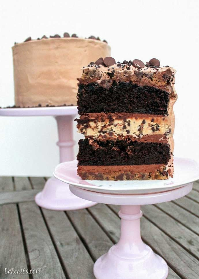 This Midnight Binge Cake has layers of chocolate cake, chocolate chip cookies, and chocolate chip cookie dough, sandwiched with creamy chocolate fudge frosting & whipped chocolate marshmallow frosting! This is one decadent celebration cake recipe sure to impress.