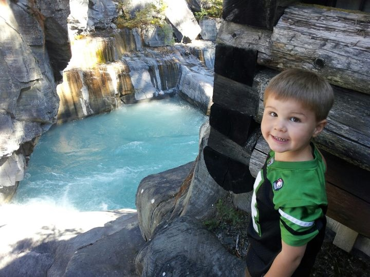 hunter looking down and wondering my the river is so blue.. In the Rocky mountains!