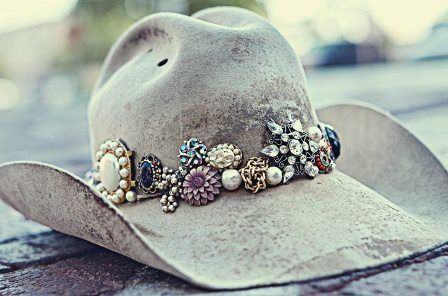 Embellish your hat!!! Awesome!!.....I checked the web site and they don't seem to have any for sale ATM, but this photo might give creative inspiration to Bling up your own!!!....I know I can't wait to add some sparkle to my old hat...wait till the neighbours see me mowing the lawn next time!!  http://rustyrose.mybigcommerce.com/