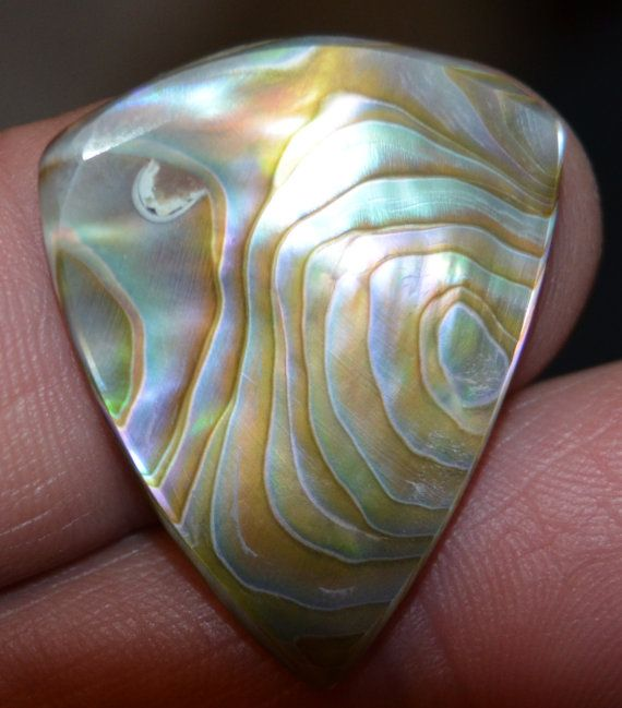 For the musicians... Custom Guitar Pick Hand made in real abalone by Highrroad.
