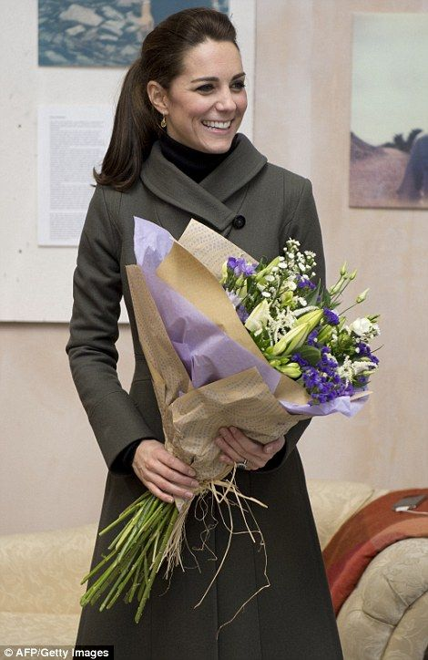 The Duchess of Cambridge received yet another bouquet of flowers when she paid a visit to a photographic exhibition entitled Mute: are you being heard? from a mental health project run by Ynys Mon and Gwynedd's local 'Mind' charity in Caernarfon, north Wales