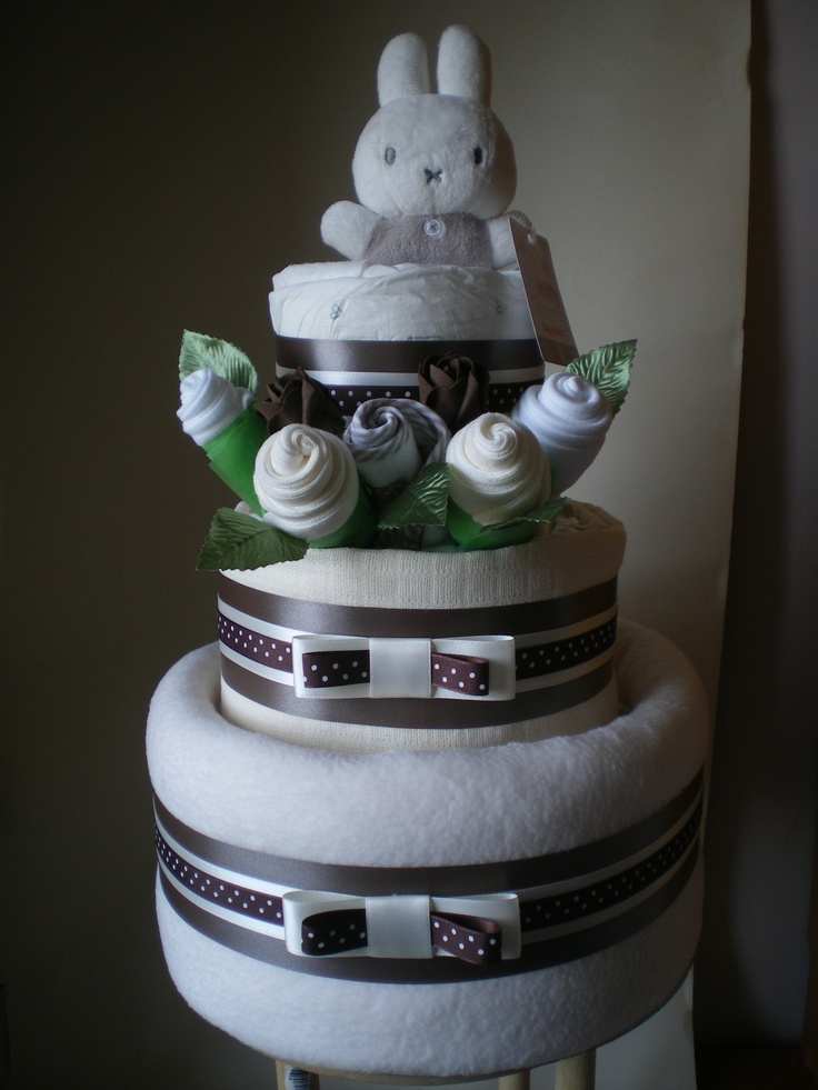Neutral 3 tier nappy cake with small Miffy plush toy and a clothing bouquet