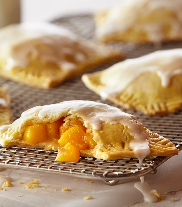 These mini peach pies are made with fresh peaches, homemade pastry crust and topped with a sweet bourbon glaze.