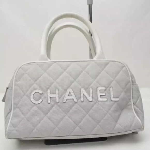"Chanel Boston bag sale was $700 Chanel Boston bag. Lovely bag with a roomy interior to use as an everyday bag. Gray canvas material with white piping. The serial number is 6828056. Bag has wear from normal use and is missing 2 rivets(feet) on the bottom of the bag. Handle is 10.63"". Please see photos for condition. Sale limited time! CHANEL Bags Travel Bags"