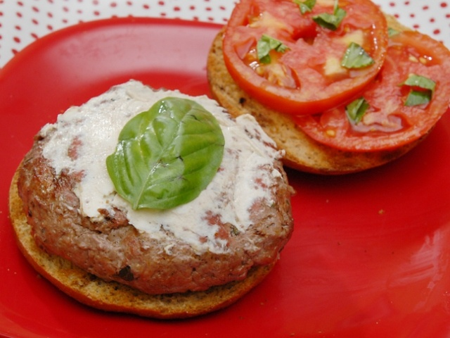 Burgers with sun-dried tomato paste, goat cheese and fresh herbs