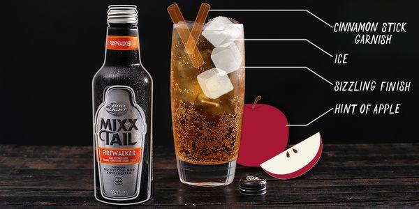 An apple wedge, cinnamon stick & serve over ice