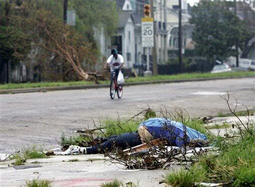 Death by Hurricane Katrina photo: It is common to see a bike rider in the streets of New Orleans but not what lays on the road side. The dead man swollen. This photo was uploaded by HURRICANES_IN_THE_GULF