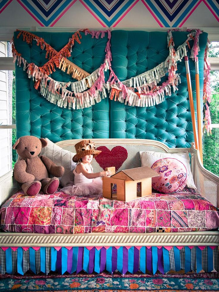 Who wouldn't love to spend hours playing in this beautiful and vibrant bedroom? (Fun fact: The garlands, bed skirt, and wall art are made out of duct tape!)