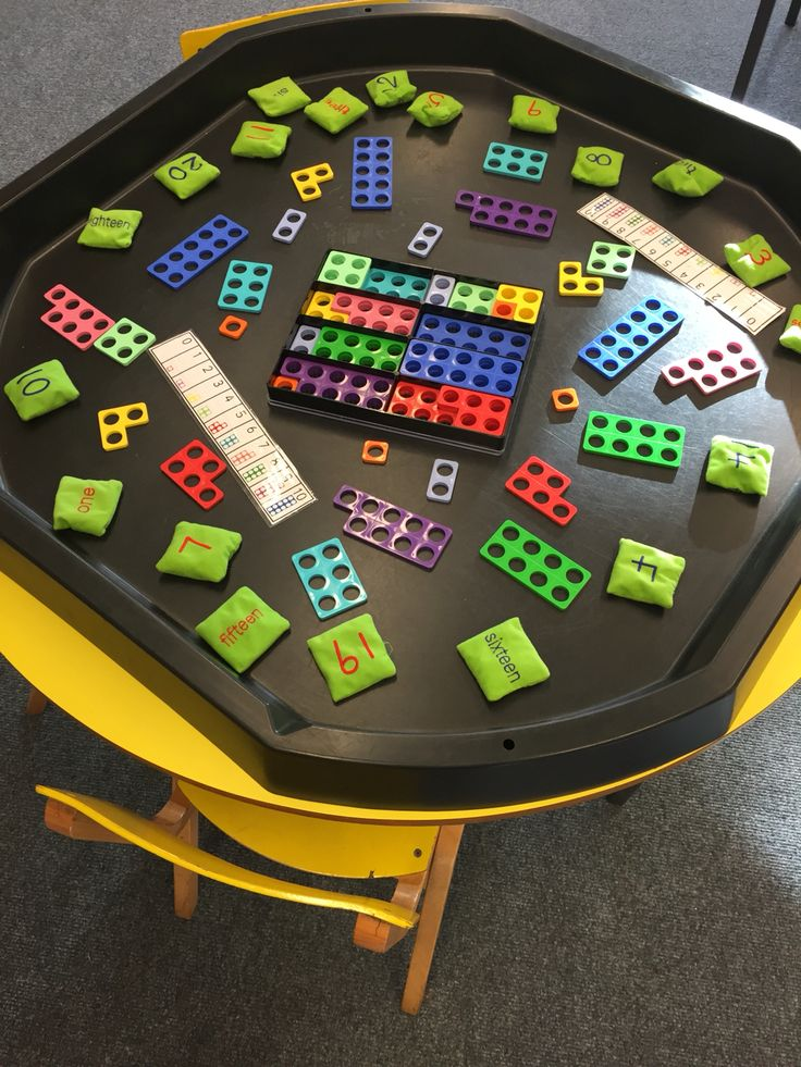 Numicon and numbered bean bags in maths tuff tray Tuff