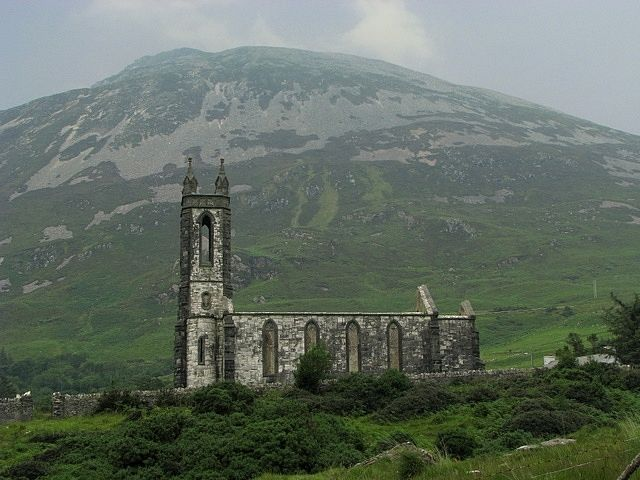 Old Church in Donegal,Ireland  Ruined church standing under Errigal Mountain in Co. Donegal. The walls are still complete and the white marble of which it was built was quarried just a few hundred yards away. The adjacent graveyard contains a single gravestone. Few will venture near the old church for it is said to be haunted