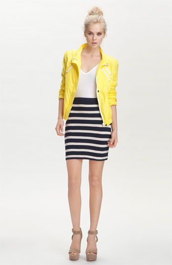yellow jacket white tee black white stripe skirt