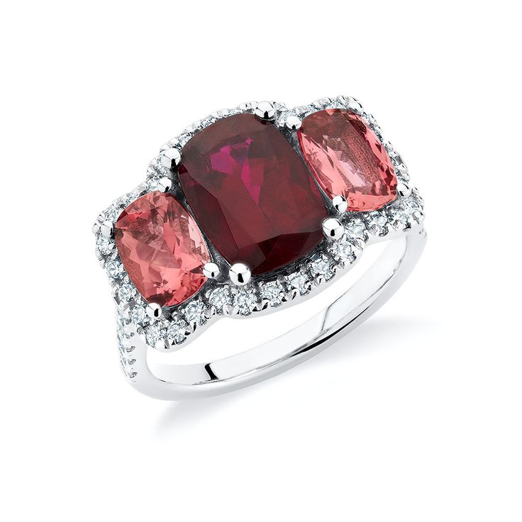 Rubellite and peachy-pink tourmalines set with diamonds in 18K white gold.
