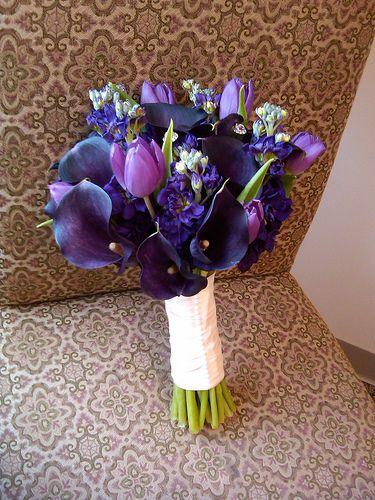 Purple calla lilies, tulips & stock blossoms bouquet.