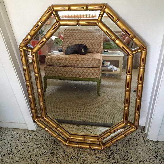 Beautiful vintage faux bamboo octagon resin mirror. Hollywood Regency/Chippendale/Palm Beach style. The finish is metallic gold/gilt color. Its in good