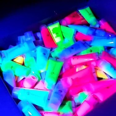 Some UV Face Body Paint tubes under a UV Lamp: https://weheartit.com/glowpaint