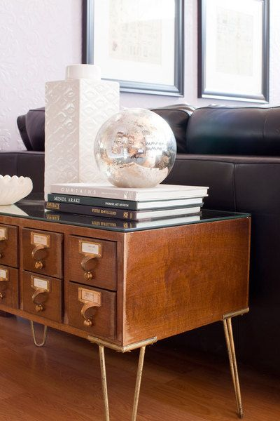 Such a neat idea! Turning a found library card catalog into a coffee table by adding hairpin legs and a mirror top