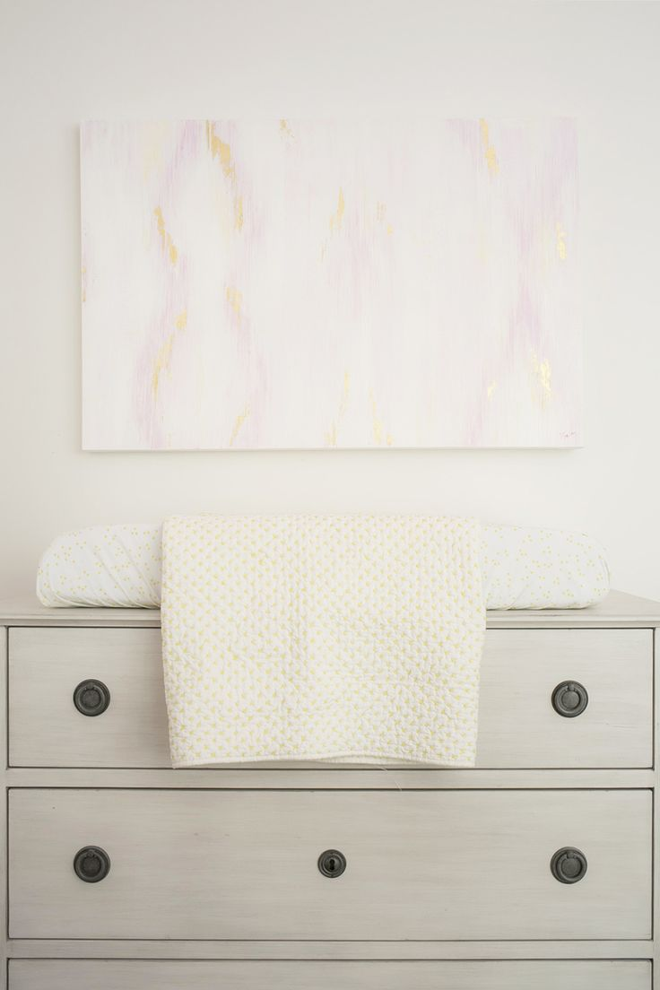 "I created this soft Ikat painting to pull in the colours of this space by Interior Designer ""Winter Daisy.""    www.winterdaisy.com  Photography : Rebecca Dadson Read More on SMP: http://www.stylemepretty.com/living/2016/10/04/designing-a-girly-nursery-this-one-is-a-must-see/"