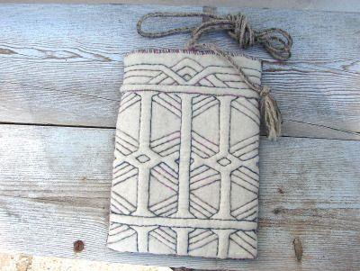 Relief quilted felt bag by Vanda Robert
