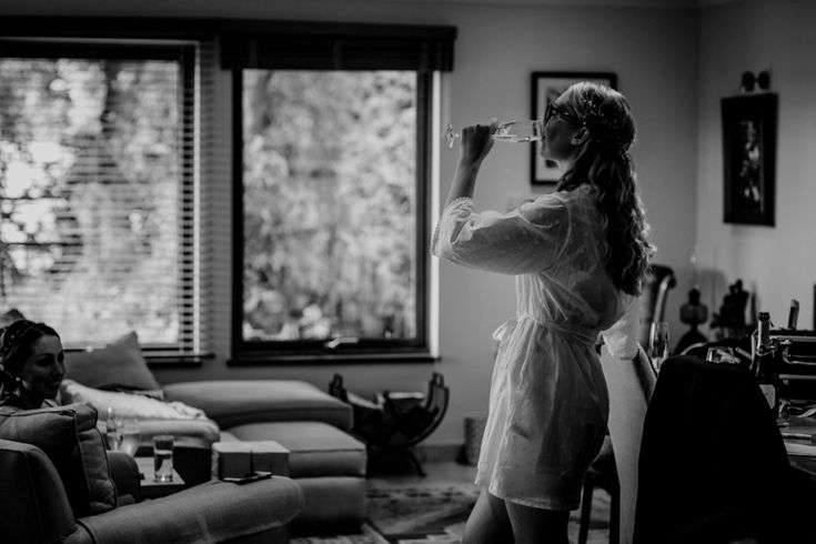 Make sure you've got the bubbly ready. Cheers! Photo by Benjamin Stuart Photography #weddingphotography #cheers #bubbly #blackandwhite #bride #toast