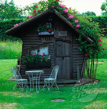 Garden shed. Cute table to sit and enjoy a cold glass of lemonade after working in the yard.