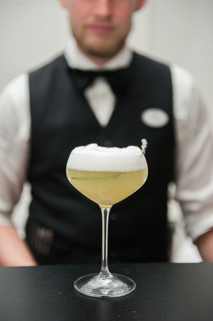 The Hotel Georgia | gin, triple sec, orange juice, lemon juice, orgeat syrup, orange blossom water, egg white, garnish with lavender | Jenny & Daniel | Photography by Blush Photography |
