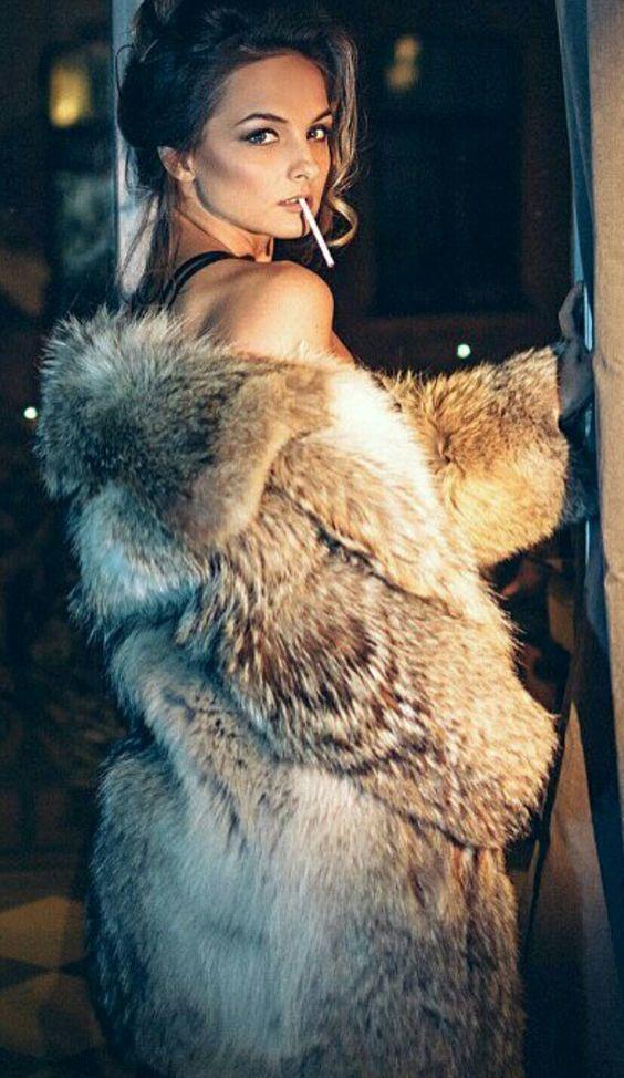 Naked women smoking in fur — 3