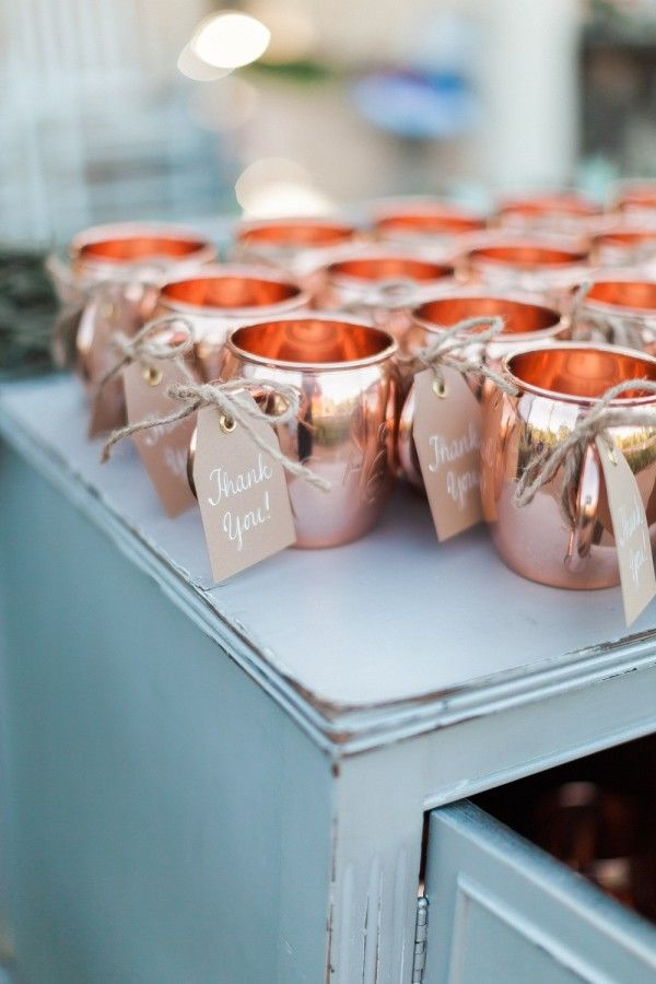 Copper mug wedding favors: http://www.stylemepretty.com/michigan-weddings/grand-rapids/2015/12/01/romantic-frederik-meijer-garden-wedding/   Photography: Blaine Siesser Photography - http://blainesiesserphotography.com/