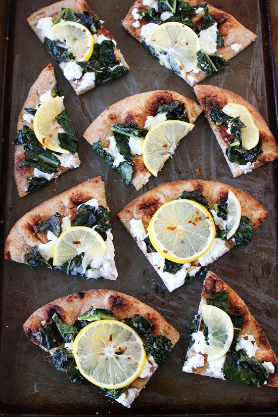 Meyer Lemon, Kale, and Goat Cheese Flatbread Recipe on twopeasandtheirpod.com Love this easy flatbread recipe! Perfect for lunch, dinner, or as an appetizer for parties!